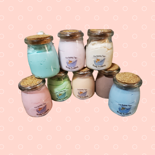 Eight jars of colorful body lotion with cork lids