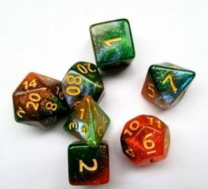 A tabletop dice set in a gradient of colors including gold, red, and green, with gold numbers.