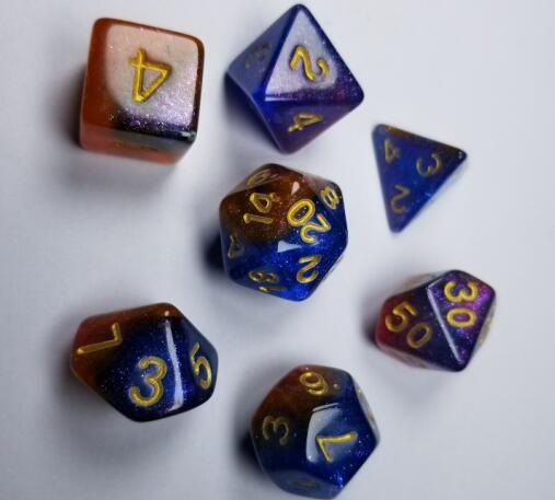 A tabletop dice set in two-tone red and blue, with gold numbers.