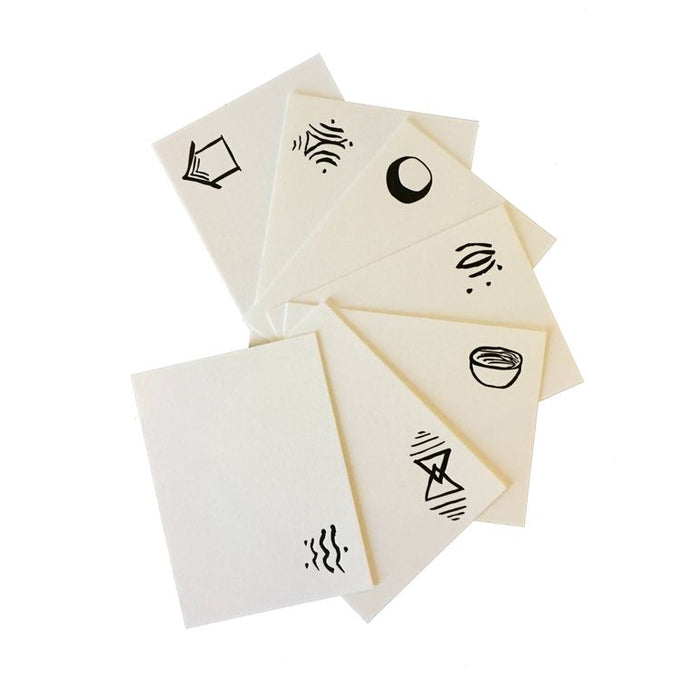 Sample of the cards, white with symbols written in the upper right-hand corner.