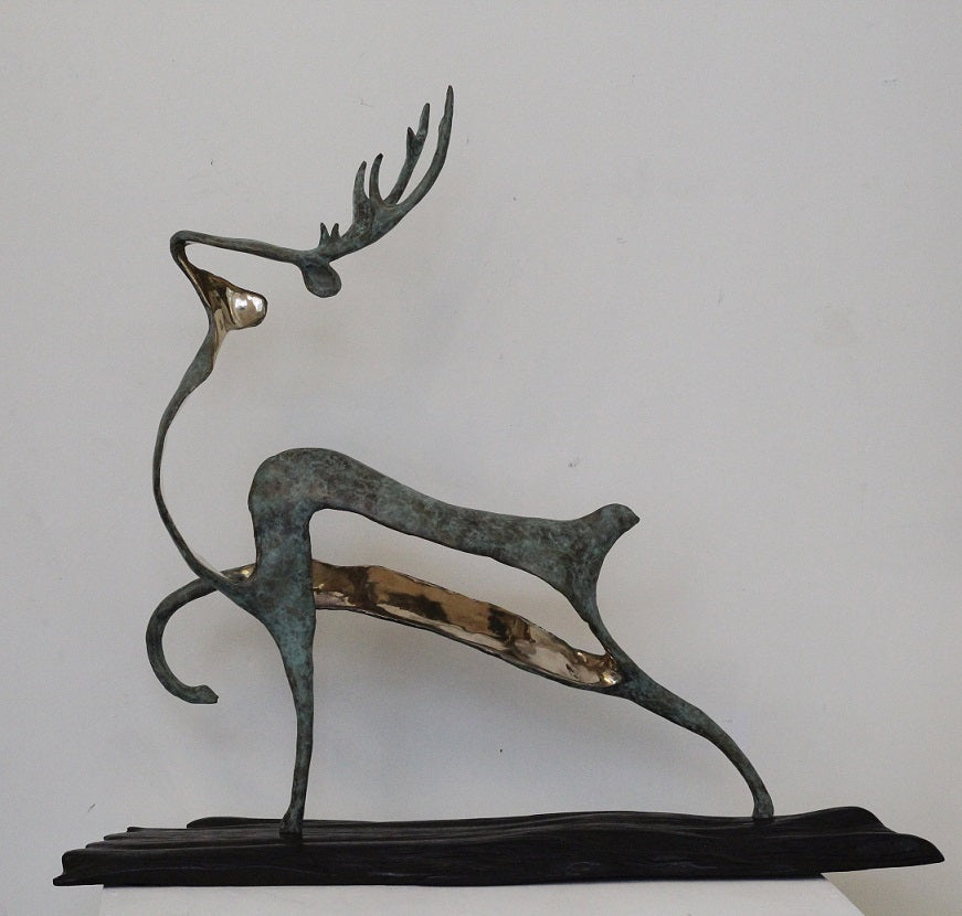 Stag , bronze on bog oak by Ani Mollereau