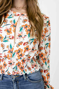 Blusa floral manga larga cut out escote