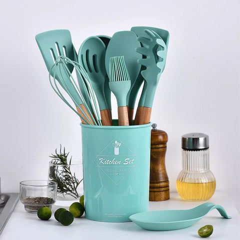 12 piece cookware and spatula set in bucket on table.