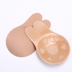 Nude color front and back of breathable bio-silicone breast lifting stickers.