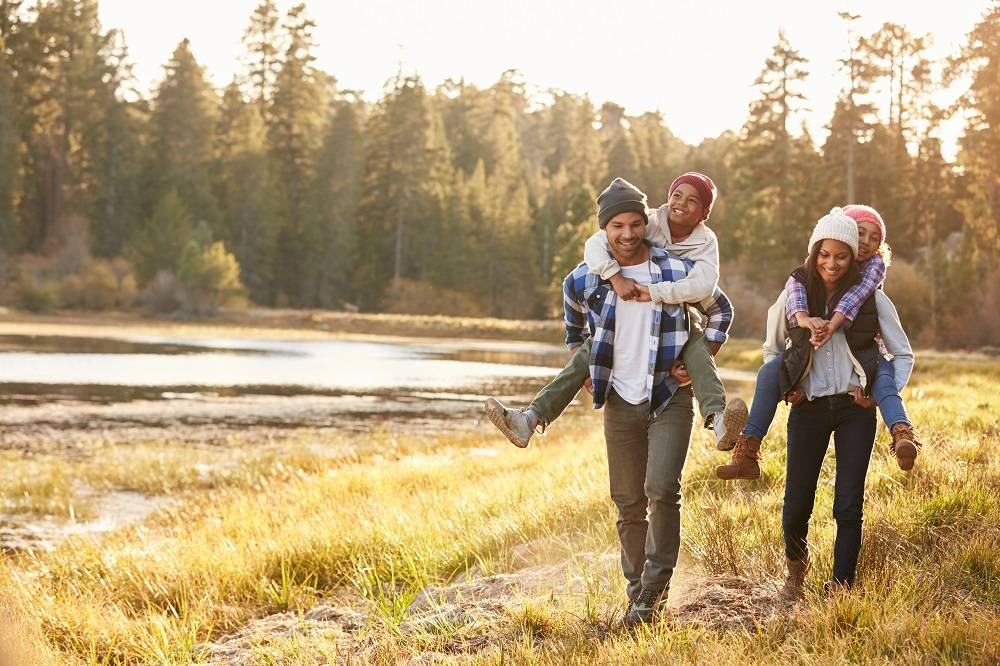 healthy happy children with parents hiking in nature  - dendera naturally
