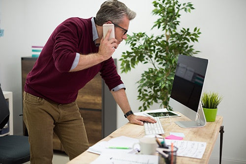 business man working from standing desk