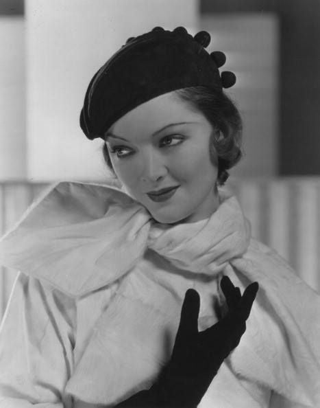 Myrna Loy in a beret and suede gloves, 1932