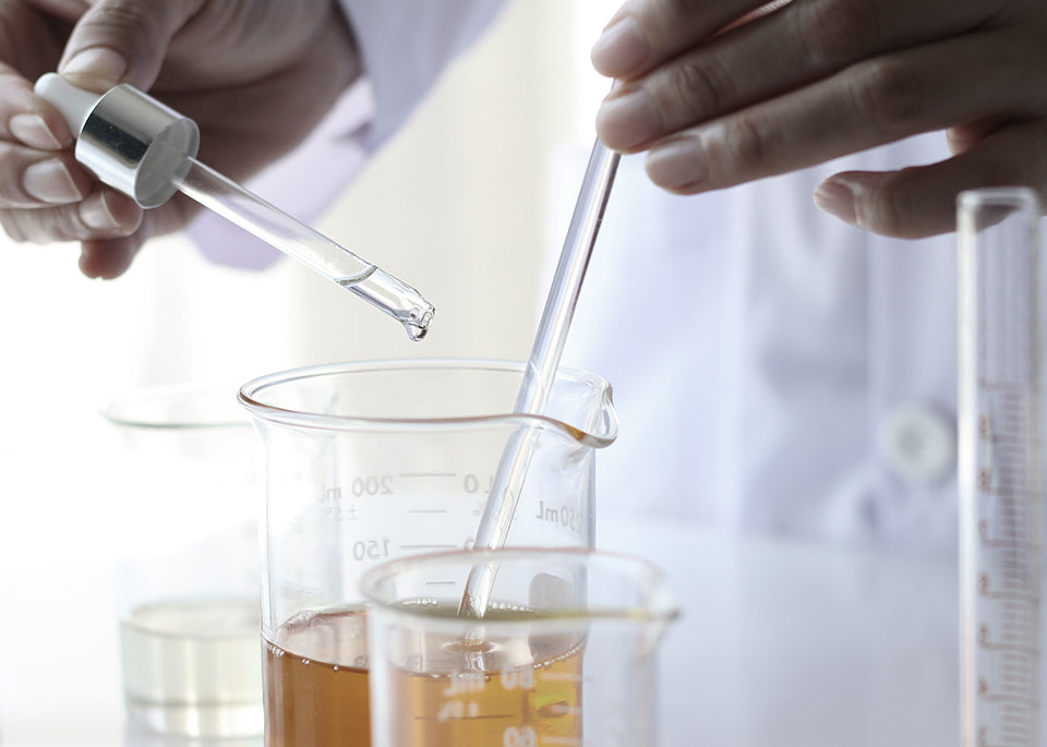 a scientist testing skincare ingredients in a lab