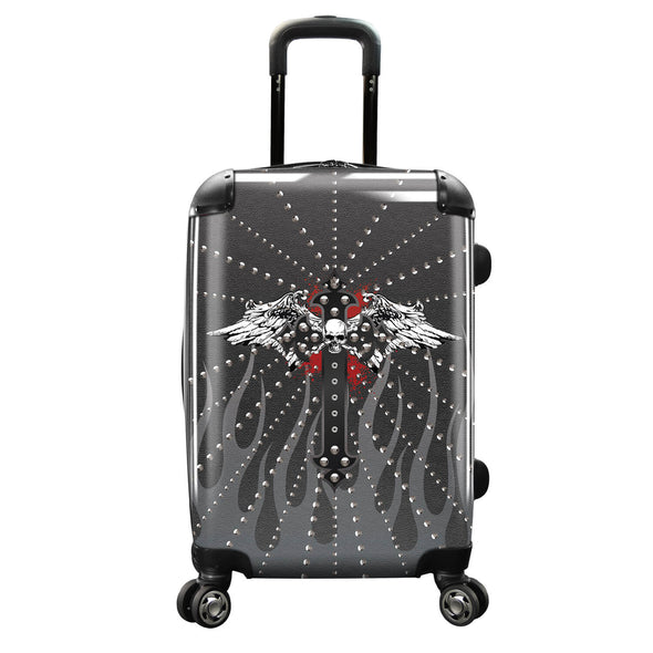 Image of a luggage that has a design of a skull with wings.