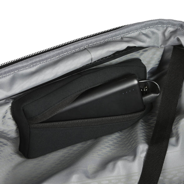 Image of portable charger going inside luggage compartment.