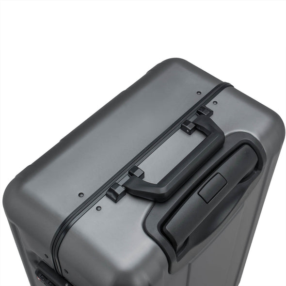 An image of the top of the silver luggage.
