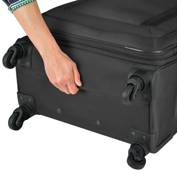An image of the bottom grips of a black luggage.