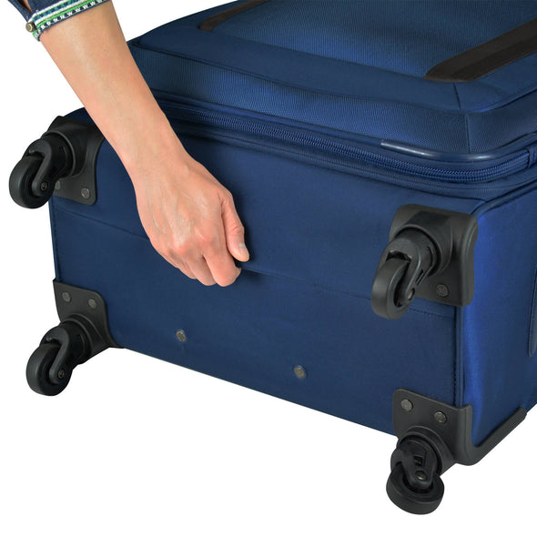 An image of a blue luggage with bottom grip handles.