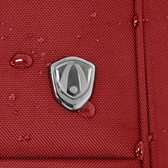 An image displaying the logo of Traveler's Choice. As well as the waterproof capabilities of a red luggage.