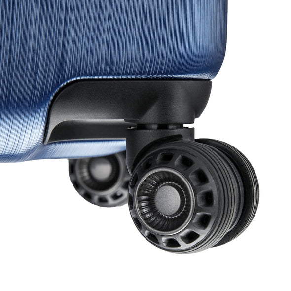 An image of a blue luggage and its black wheels.