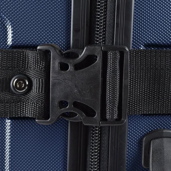 An image of the compression straps on the blue luggage.