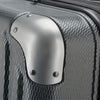 An image of the silver corner guard on the gray luggage.