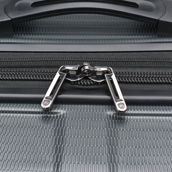 An image of the silver zippers on the gray luggage.