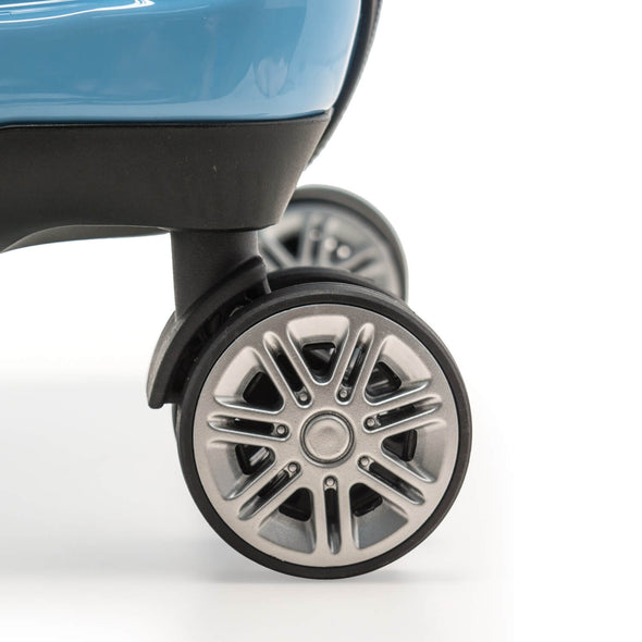 An image of a teal luggage and its silver wheels.