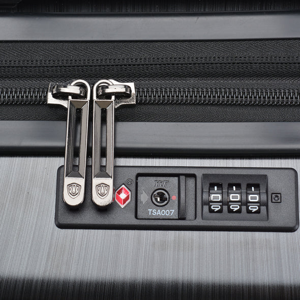 An image of the TSA007 lock on the charcoal luggage.