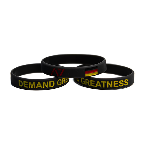 You are always working towards your goals and helping others reach their full potential. Feel the German spirit with this country wristband design that incorporates the German flag into a wristband and reminds you to always Demand Greatness. The wristband is 1/2 inch wide and features black debossed lettering.