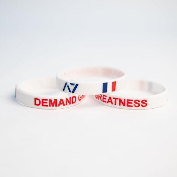 You are always working towards your goals and helping others reach their full potential. Feel the French spirit with this country wristband design that incorporates the French flag into a wristband and reminds you to always Demand Greatness. The wristband is 1/2 inch wide and features black debossed lettering.