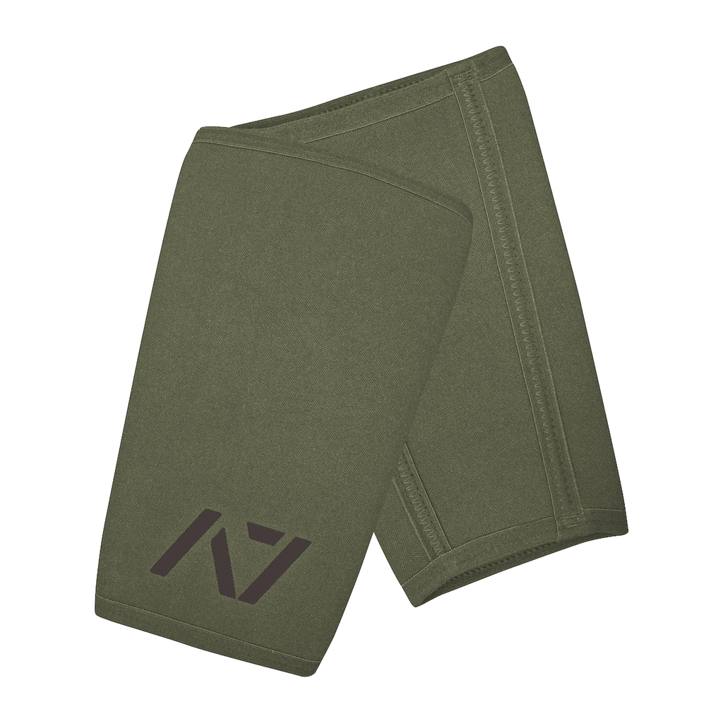 A7 IPF approved Military Green CONE knee sleeves are structured with a downward cut panel on the back of the quad and calf to ensure ultimate compression at the knee joint. A7 CONE knee sleeves are IPF approved for use in all powerlifting competitions. A7 cone knee sleeves are made with high quality neoprene and the knee sleeves are sold as a pair. The double seem on the knee sleeves create a greater tension on the knee joint. Available in UK and Europe including France, Italy, Germany, Sweden and Poland
