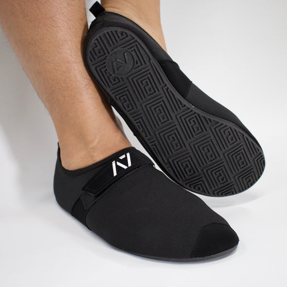 A7 Deadlift slippers easy to slip on and off and get close to the ground. IPF approved deadlift slippers. Deadlift slippers with a 3mm sole that can be used for squats, bench, deadlift or just lounging around the house. The best Powerlifting apparel and clothes for all your workouts. Best Bar Grip Tshirts, shipping to UK and Europe from A7 UK. Deadlift slippers Available in UK and Europe including France, Italy, Germany, Sweden and Poland