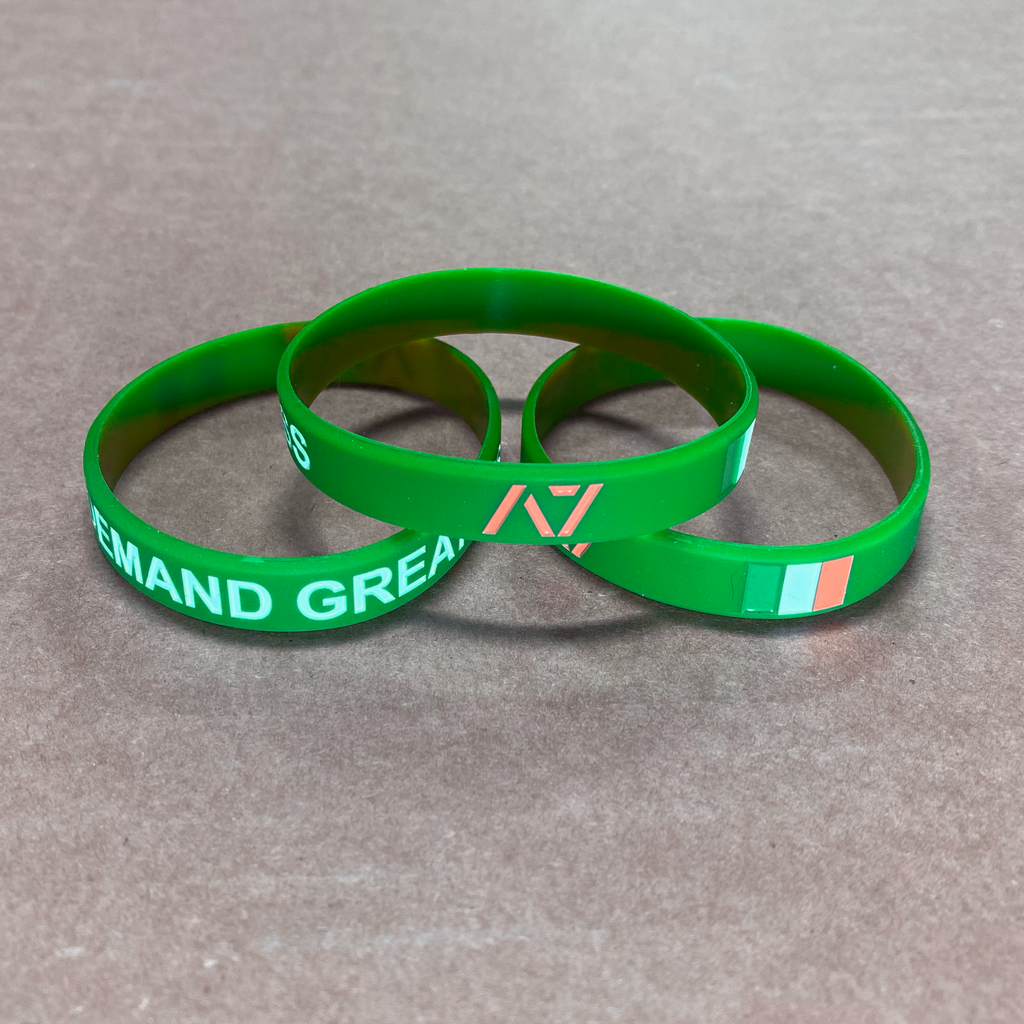 You are always working towards your goals and helping others reach their full potential. Feel the Éire spirit with this country wristband design that incorporates the Irish flag into a wristband and reminds you to always Demand Greatness. The wristband is 1/2 inch wide and features black debossed lettering.