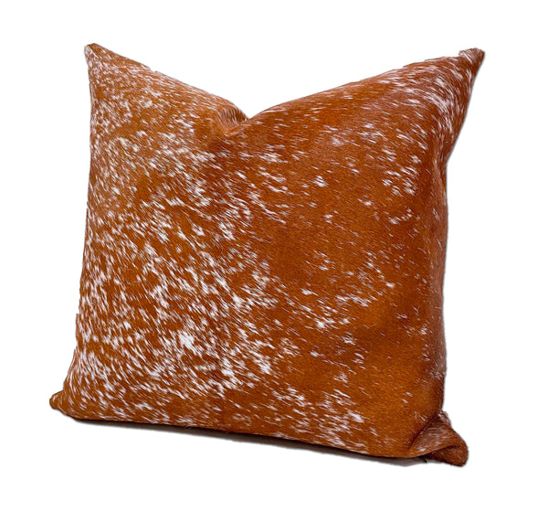 brown white cowhide pillow