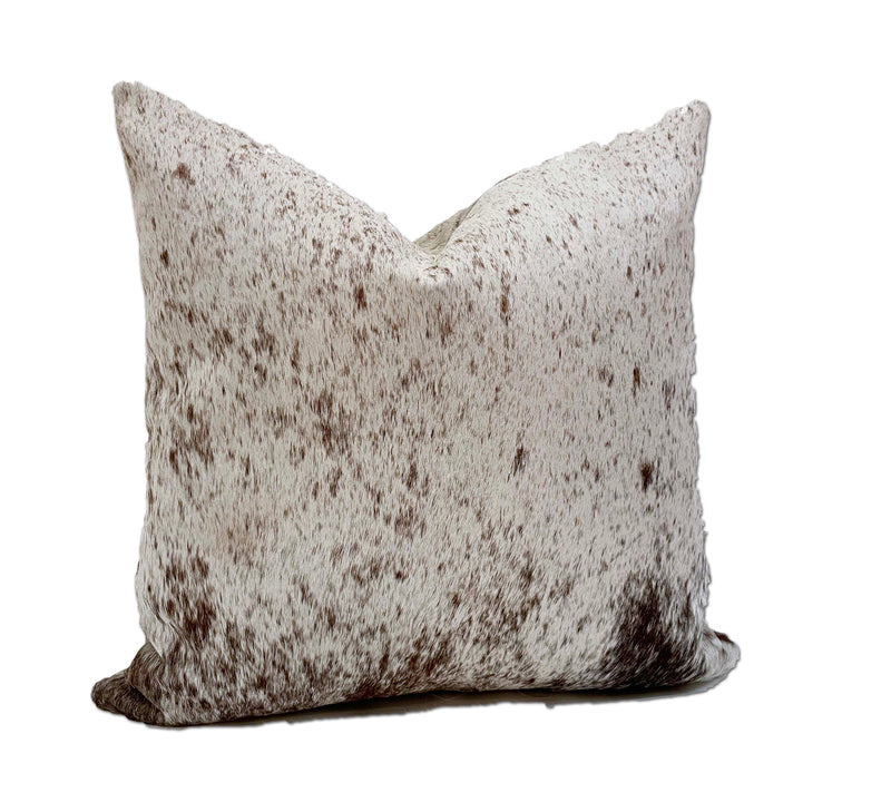 white brown cowhide pillow