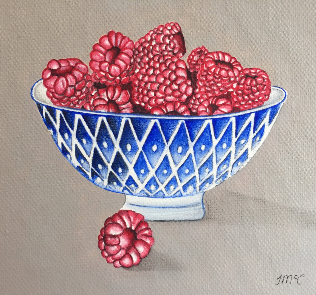 Blue bowl of Raspberries