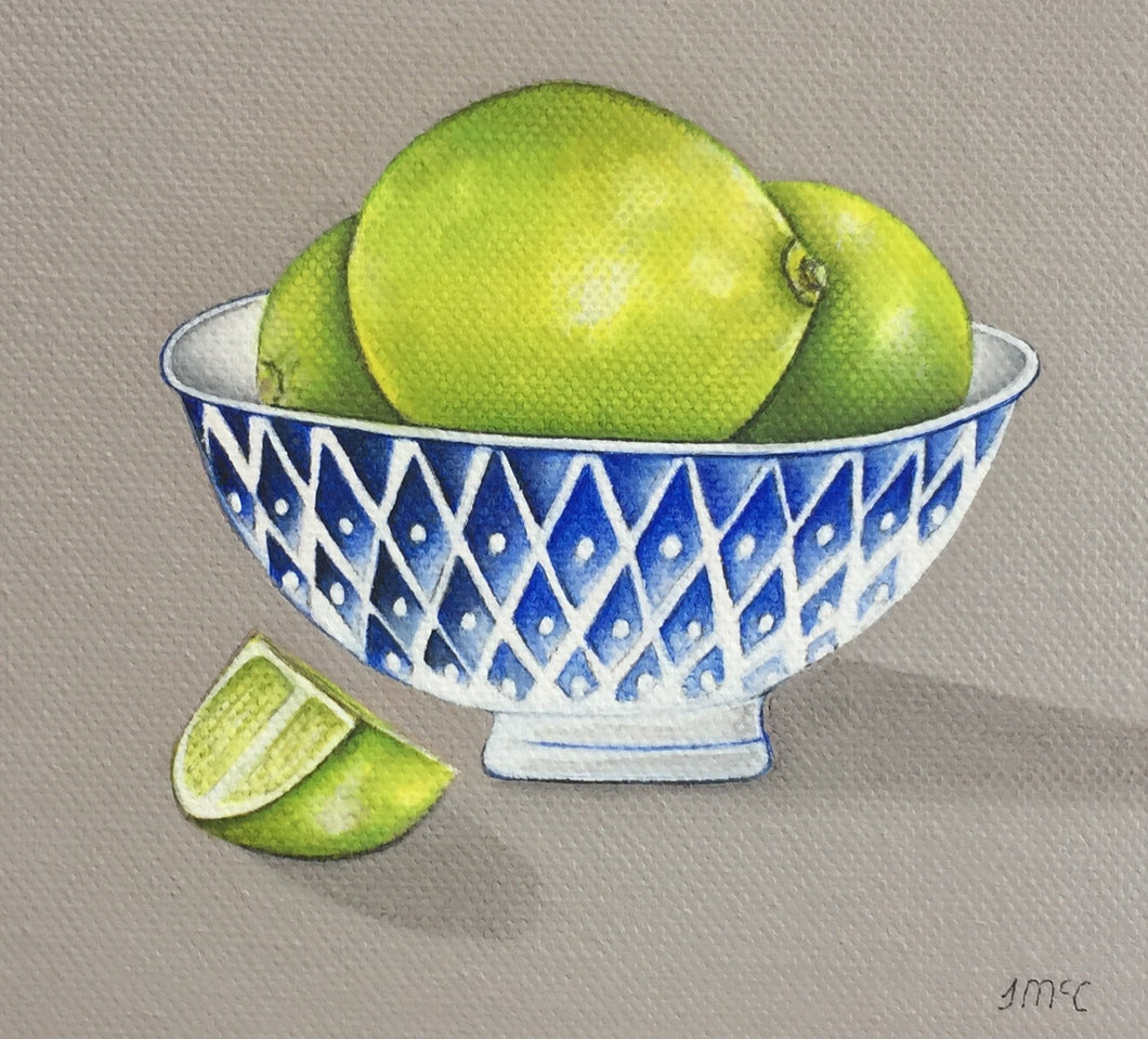 Blue bowl of Limes