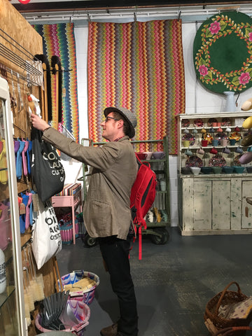 Man looking at merchandise in shop