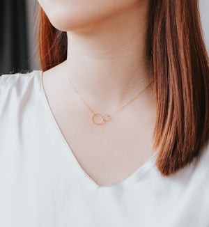 model wearing gold circle pendant friendship necklace