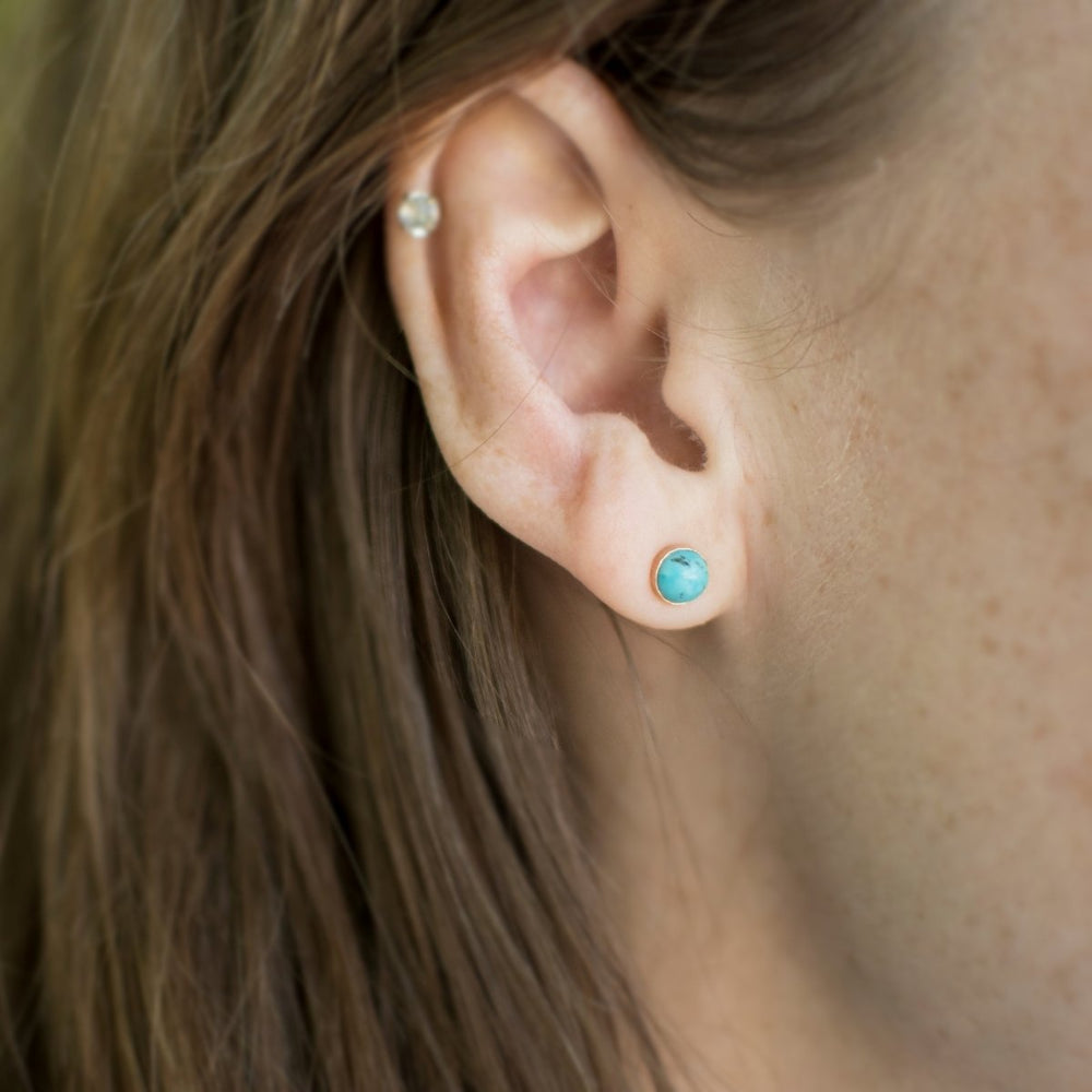model wearing turquoise stud