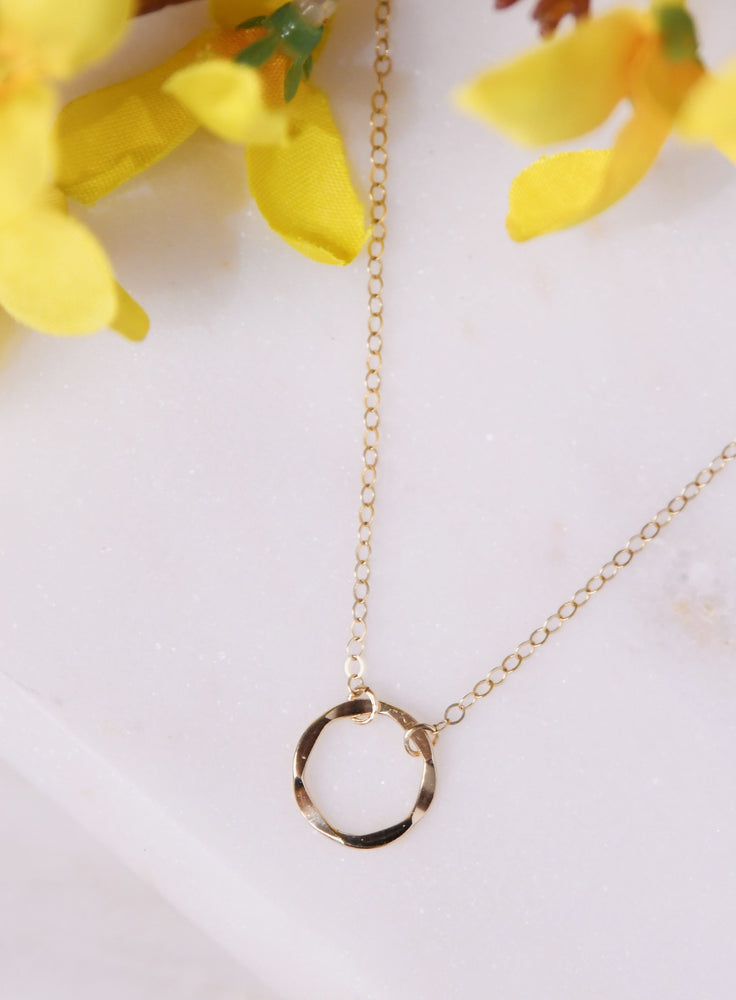 Gold circle short karma necklace
