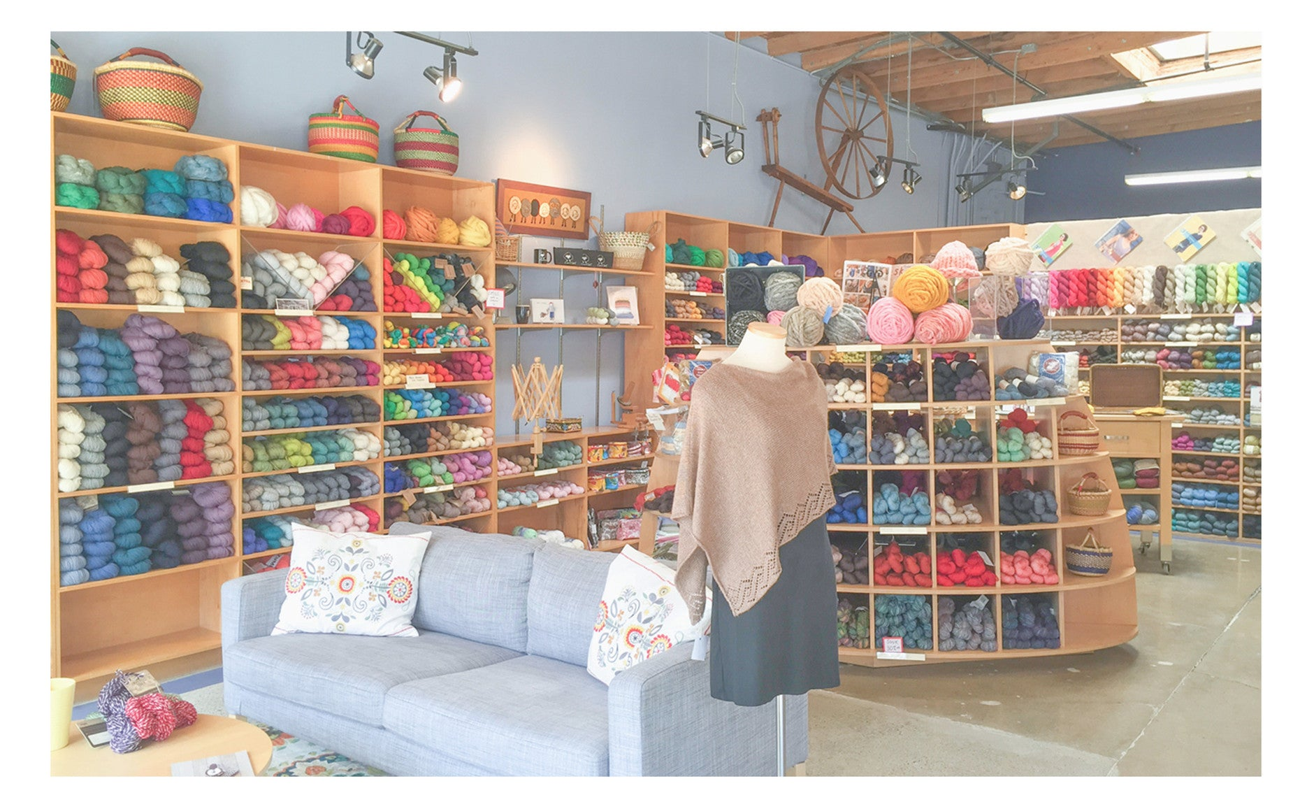 Interior image showing a seating area, yarn and sample knits.