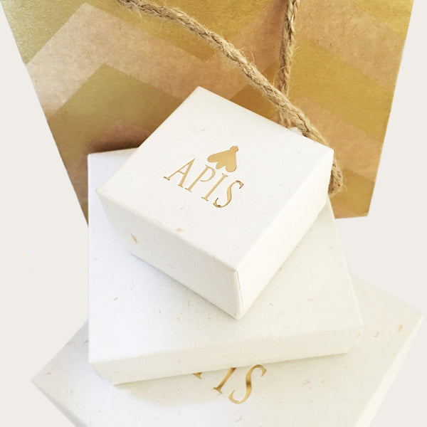 Apis white and gold boxes and packaging