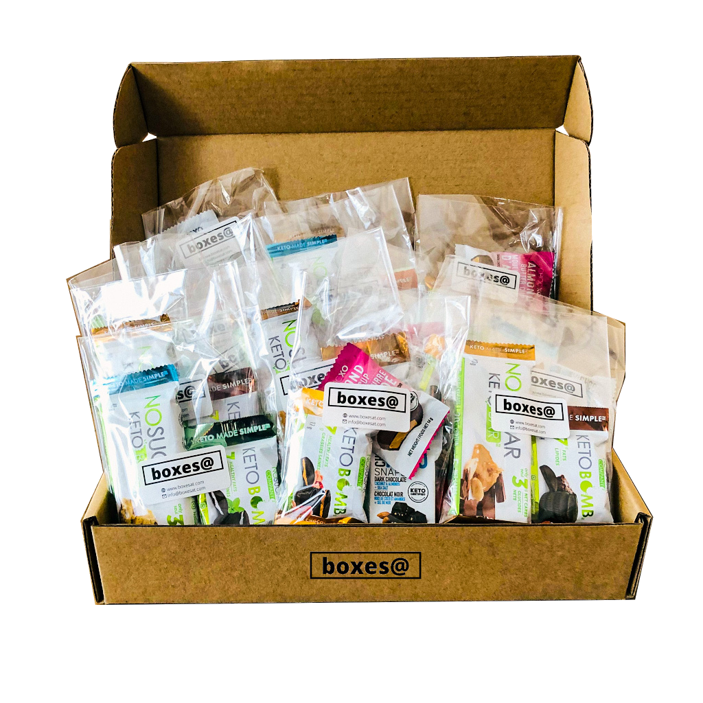 Boxesat keto snack box containing a variety of prepackaged keto bars, keto bombs, keto chocolate snaps, peanuts and almonds