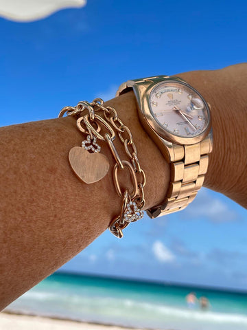 Oval chain link bracelets and yellow gold rolex