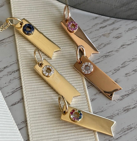 18K gold ribbon charms in diamonds and gemstones