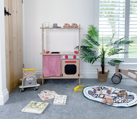 wooden kitchen with wooden toys