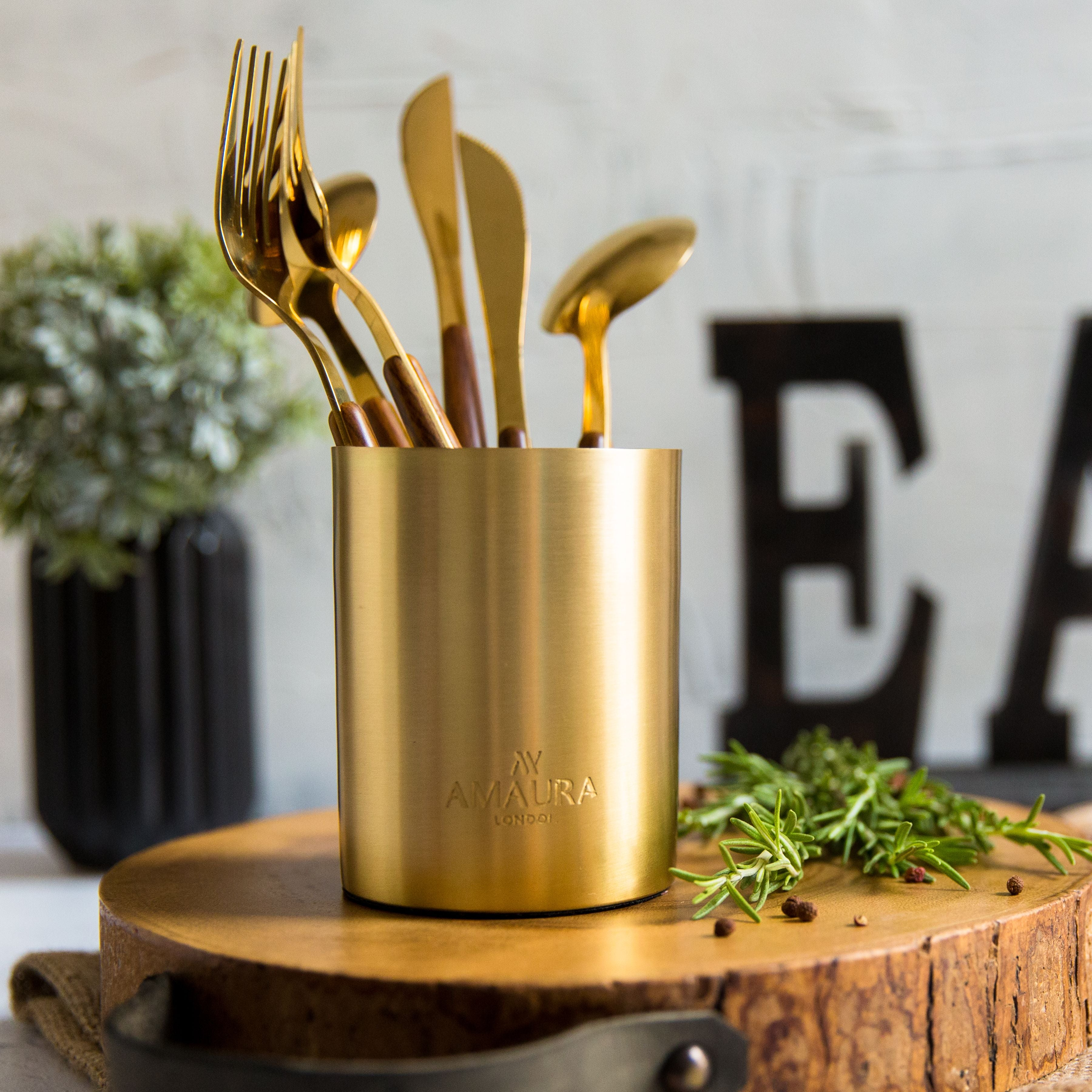 candle vessel upcycled into cutlery holder