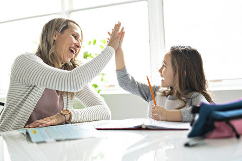 Mom and Daughter High Five