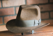 Load image into Gallery viewer, Handcrafted replica fedora modeled after the iconic hat worn by Harrison Ford as Indiana Jones.