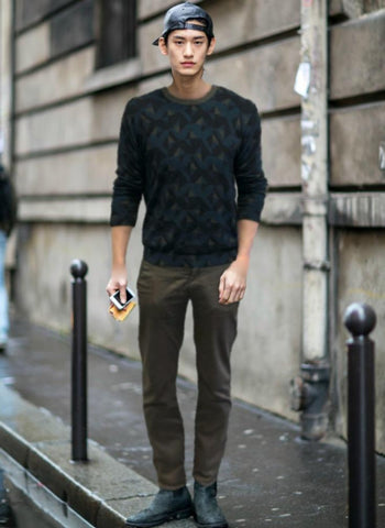 Geometric graphic sweater with gray pants