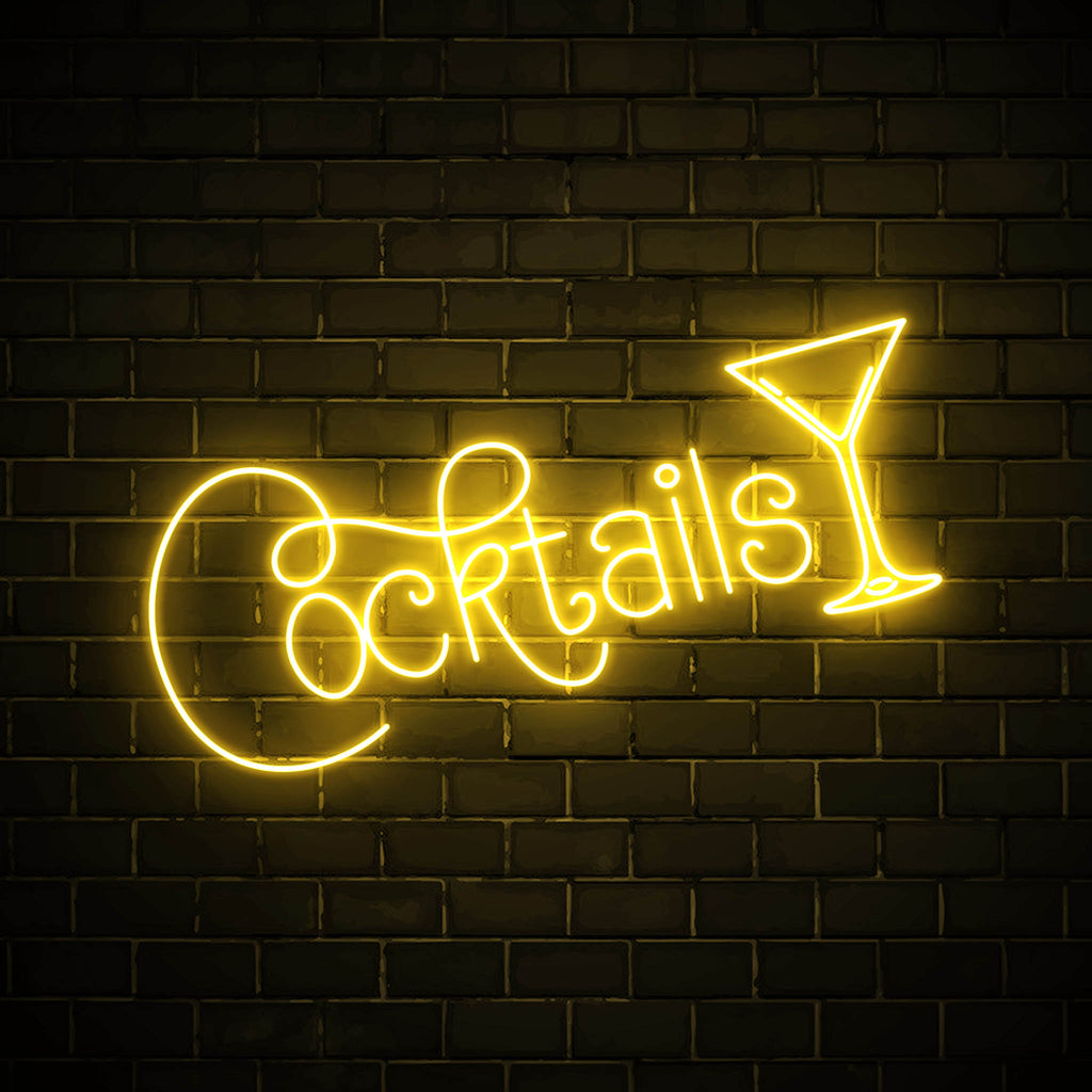 Cocktails with a glass LED yellow neon sign wall art for party