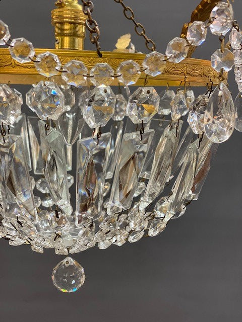 A Stunning Vintage Crystal Chandelier with Gilt Leaves