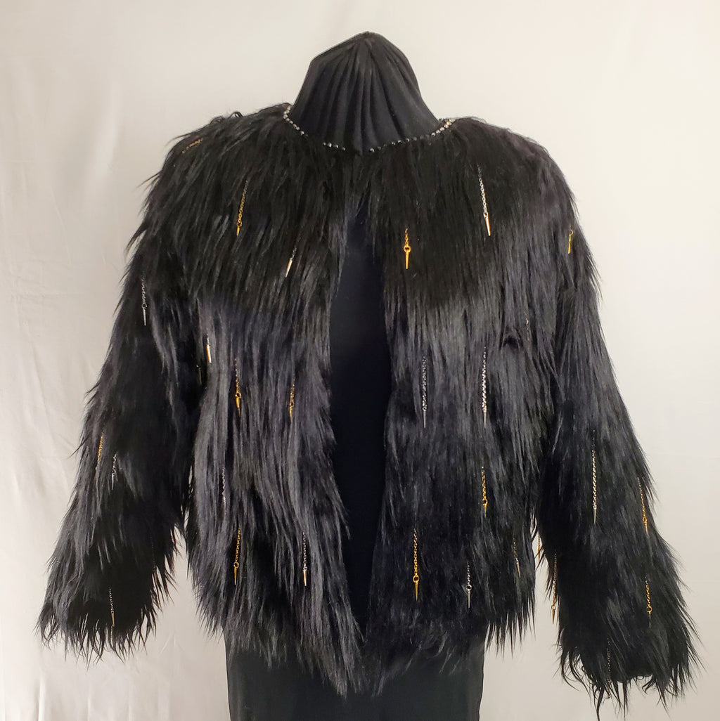 faux fur black coat with chain and spike details front view